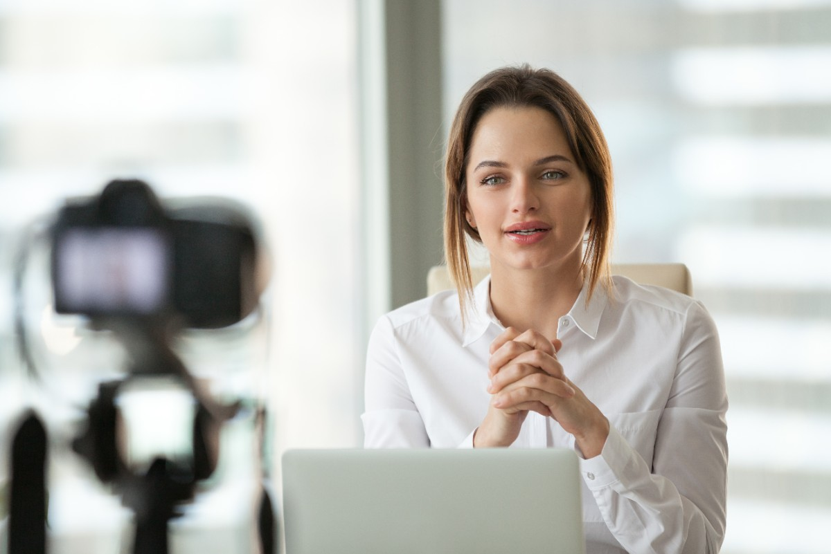 Female executive live-streaming video to colleagues